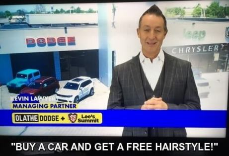 Photo: car salesman in front of car lot, salesman has hair styled upward into a point. Caption: Buy a car and get a free hairstyle!