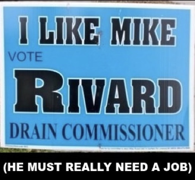 Election yard sign: I like Mike Revard for Drain Commissioner. Caption below sign: (He must really need a job)