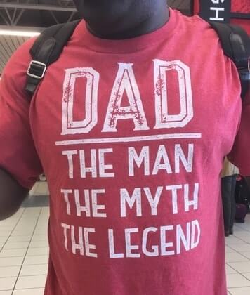Man wearing t-shirt that says:  Dad, The Man, The Myth, The Legend.