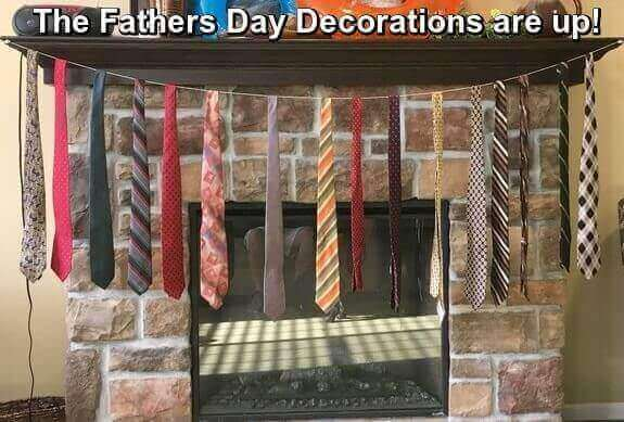 A collection of neckties hung like Christmas stockings from a fireplace mantelpiece. Caption: The Fathers Day Decorations Are Up!