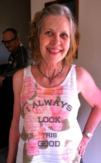 Mothers Day Jokes: photo of smiling mom wearing t-shirt that says,