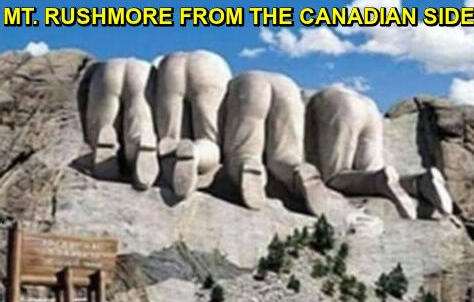 Photo of 4 men's bottoms and legs appeared to be carved in stone. Caption: Mt. Rushmore from the Canadian Side.