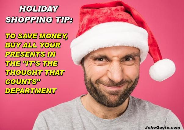 Photo: guy wearing  Santa hat and a devolish grin. Caption: Holiday Shopping Tip: To save money, buy all your presents in the